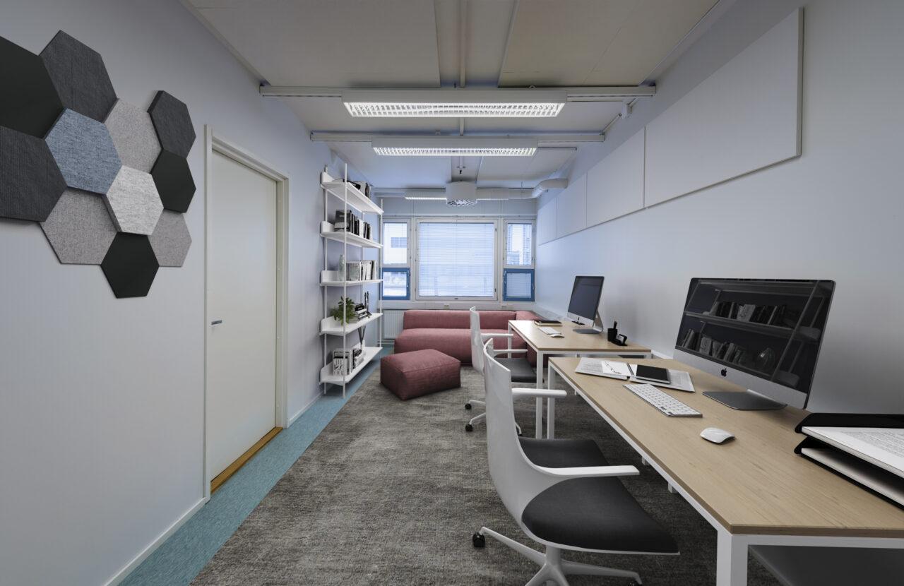 Hybridityö: tiimin tai kaksihenkisen yrityksen siisti toimitila. Seinän vierustalla tyylikkään työpisteet. Ikkunan vieressä taukoiluun soveltuva sohva.